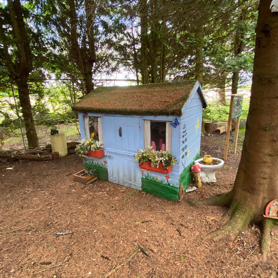 Wendy house surrounded by trees