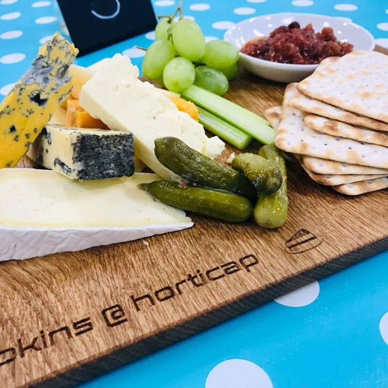 wooden board with cheese and crackers